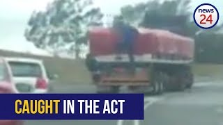 WATCH: Moving truck fails to shake off looters