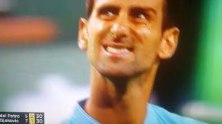Novak Djokovic sees himself grimacing on the big screen and immediately closes his mouth