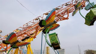 A joyful ride for kids at an amusement park / India's village fair