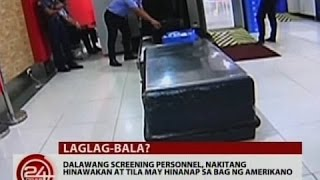 24Oras: 2 screening personnel sa NAIA, nakitang hinawakan at tila may hinanap sa bag ng Amerikano