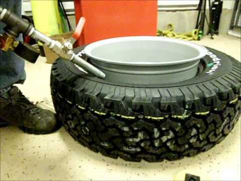 Closeup Air Blasting Tire On Wheel