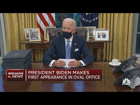 President Joe Biden signs his first executive orders