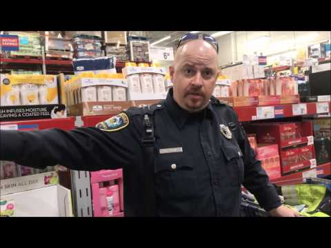 OFFICER RUNS TO STORE MANAGER FOR HELP