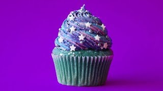Vanilla base with a swirl of buttercream frosting, glitter sprinkle...