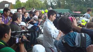 Novak Djokovic and Andy Murray signing autographs after practice Wimbledon 2011