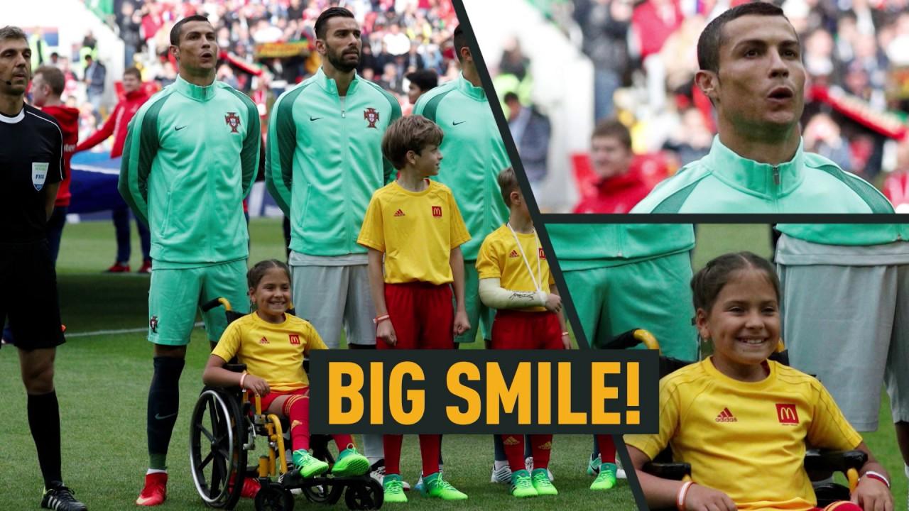 'Unbelievable emotions': 10yo girl in wheelchair kissed & hugged by Ronaldo