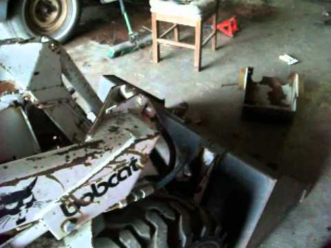 Working on the bobcats hydraulics - YouTube