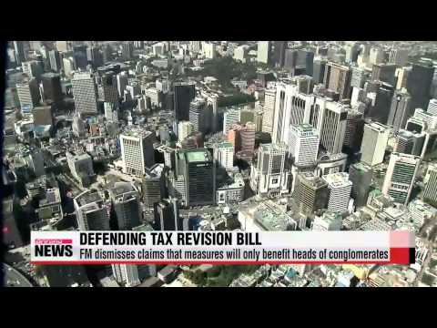 Finance minister defends government's tax revision