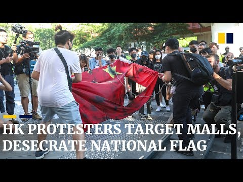 Hong Kong protesters target malls, desecrate national flag