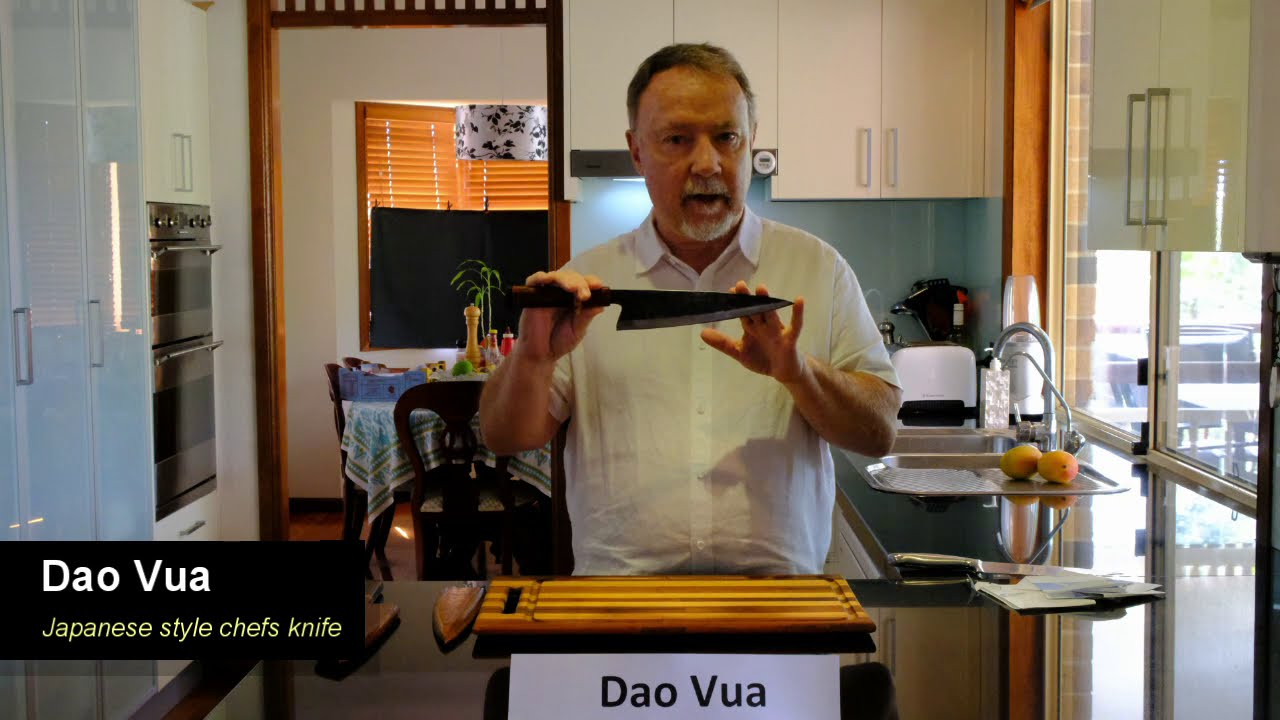 Demonstrating how sharp a Dao Vua japanese style chef's knife is