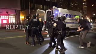 USA: Car drives through line of police amid chaotic Brooklyn protest