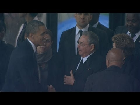 President Obama shakes hands with Cuba's...