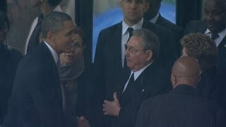 President Obama shakes hands with Cuba