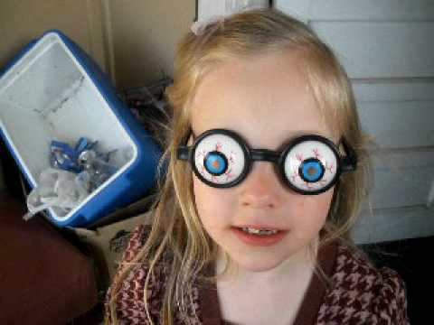 Funny eye ball glasses with missing teeth..