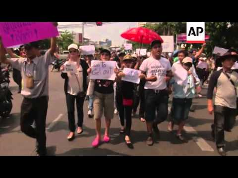 Anti-coup protesters defy military's ban on large gatherings, march blocked buy soldiers