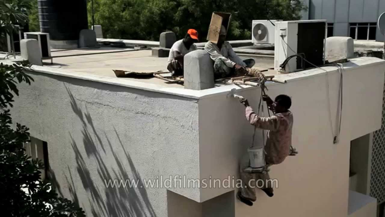 Workers paint the outside of a building in india risky business youtube - High build exterior paint set ...
