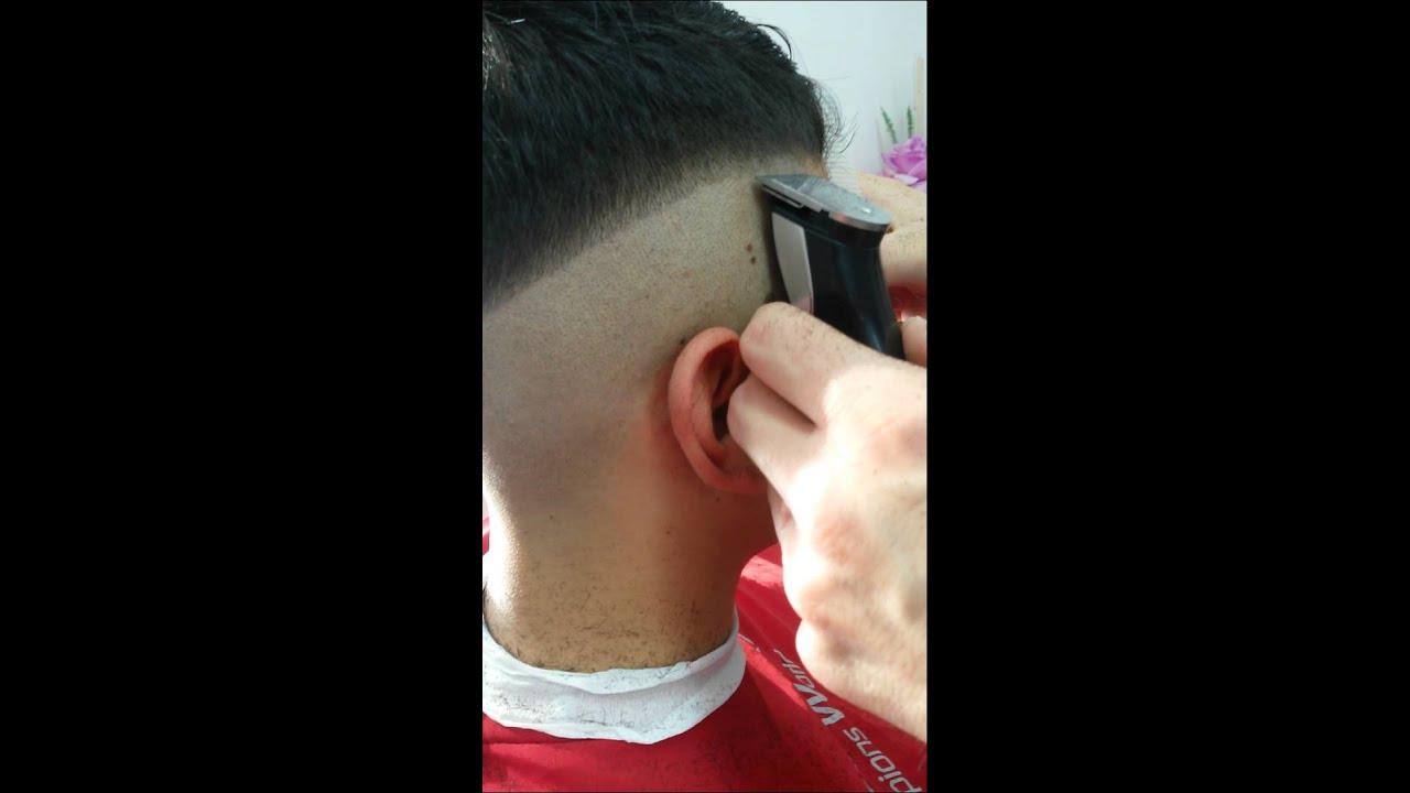 Taglio capelli sfumatura bassa