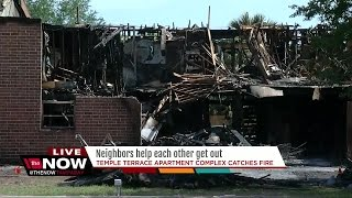 Neighbors help each other get out apartment fire