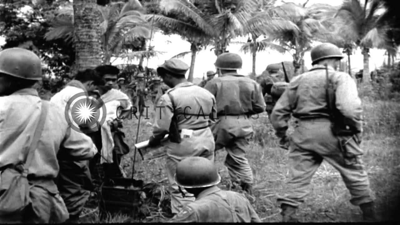 187th Glider Infantry soldiers enter Sulac, Philippines ...