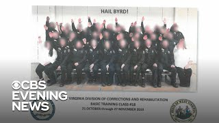 Photo shows class of corrections officers giving apparent Nazi salute