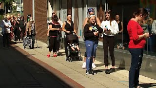 video: Inside England's first day back at the shops: queuing all night, stockpiling buttons and the big face mask divide