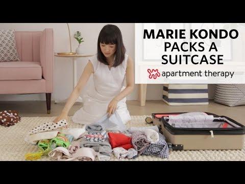 This Video of Marie Kondo Packing a Suitcase Will Make You Rethink All the Junk You Normally Take on Vacay