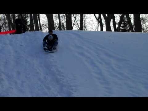 Justin snow sledding 1