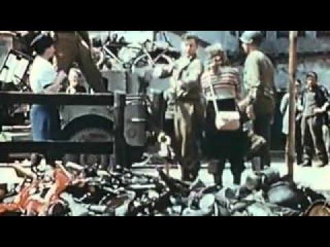 Civilians strike German officers after the Germans surrender in Milan, Italy duri.HD Stock
