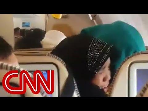 Heavy turbulence scares passengers on Ethiad flight - YouTube