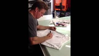 Chip Foose Draws An Early Bronco Freehand On Tom's Bronco Parts Shirt