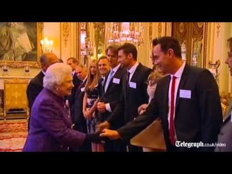 Elle Mcpherson and Hugh Jackman attend reception at Buckingham Palace with the Queen