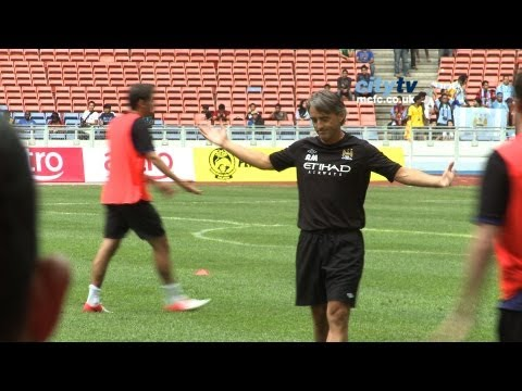 CITY IN MALAYSIA: Roberto Mancini scores in training during first 24 hours in Kuala Lumpur