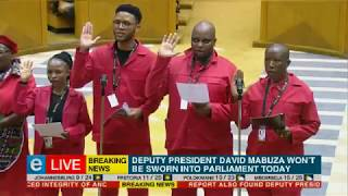 Julius Malema dances on his way to being sworn in