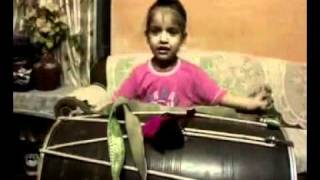 Little Kid Playing Traditional Dhol Beats