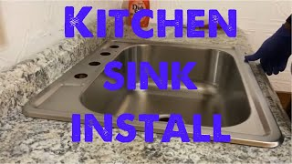 Install kitchen sink and faucet