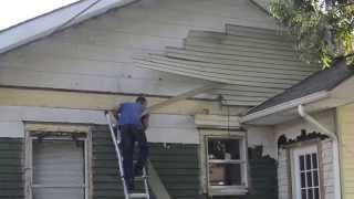 Removing aluminum from rear gable of 1917 Eastwood Bungalow in Houston