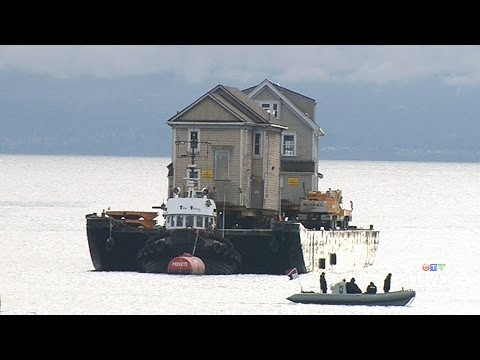 Heritage Homes Floated Through Victoria's Inner Harbour