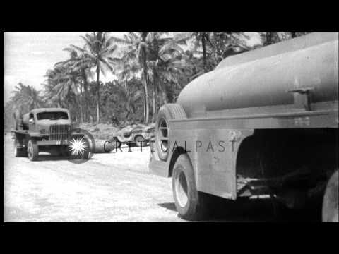An airman fuels a P-39 Airacobra and construction battalion personnel lay mats in...HD Stock Footage