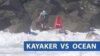 Kayaker Gets Washed Into Rocks