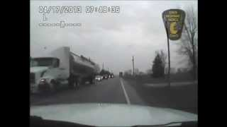 Tractor-Trailer passes stopped School Bus in Logan County