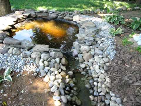 Backyard waterfall, pond and stream.. and dog! - YouTube