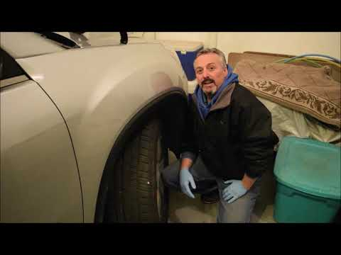 Car Repair: Installing a Head Light Bulb on a GMC Acadia, Chevy Traverse, Saturn Outlook. Enclave
