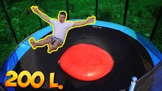 jumping-on-a-200-liter-giant-water-balloon-laying-on-a-trampoline