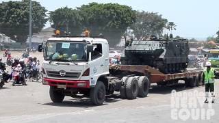 11 Heavy Haulage Trucks Convoy Transporting Army Tanks leaving the exhibition grounds