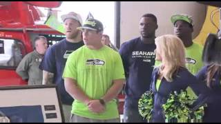 Seahawks adopt U S  Coast Guard 13th District in USAA Change of Command ceremony at JBLM