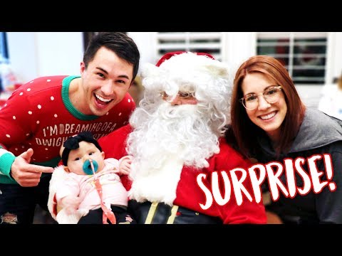 Santa Surprises Baby with Her FIRST GIFT!