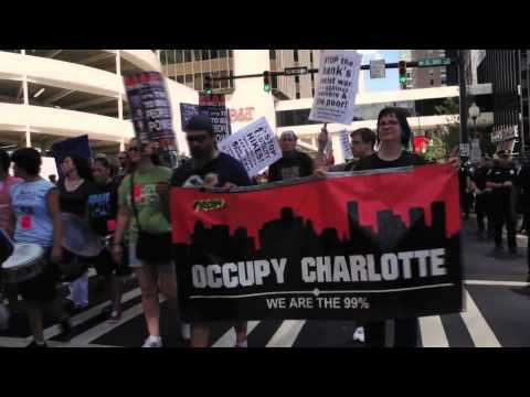 Jasiri X - Charlotte: Activists Kick off the 2012 DNC by Marching on Wall Street South