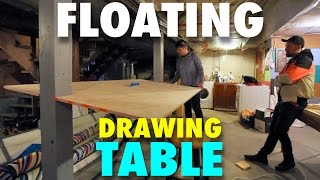 """Michael Markowsky constructs a """"floating"""" drawing table in the centre of his new art studio, and then creates of drawing of the"""