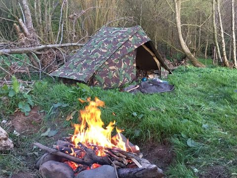 Solo river bank camp with my Canvas tent and salmon with wild garlic