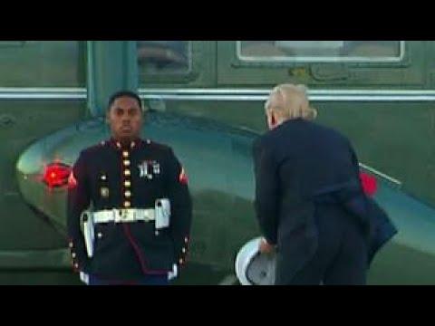 President Trump picks up Marine's hat in viral video